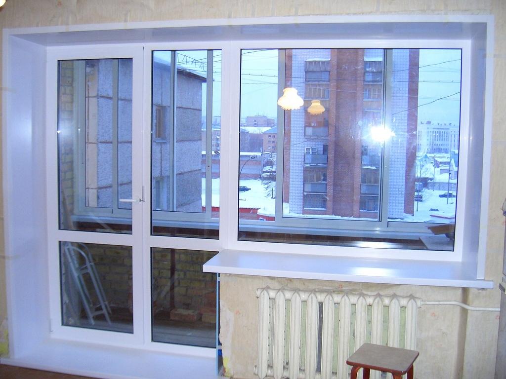 Однокамерные двустворчатые балконные пластиковые двери..