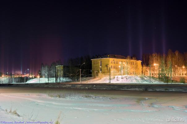 """Явление """"Световые столбы"""" в парке, январское фото.  Ухта"""