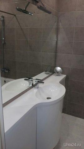 Завершено. Мебель в ванную комнату. Фасады: камень, столешница: камень,мойка интегрированная: камень. Зеркало.  Ухта